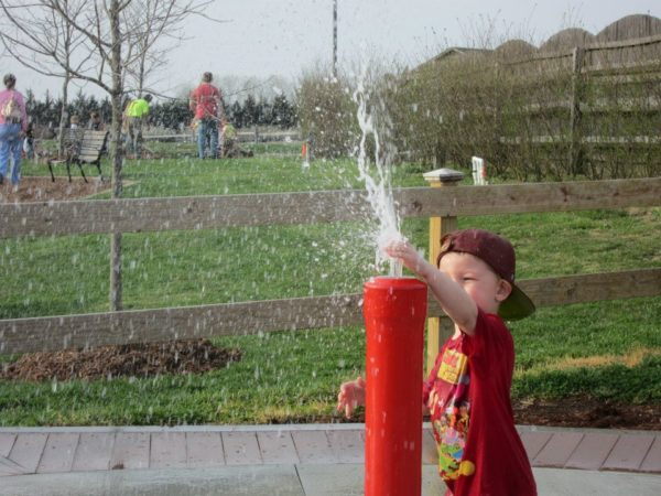 Rebekah's son enjoying the splash pad