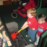 Shoveling &quot;coal&quot; into the engine at Railway Play