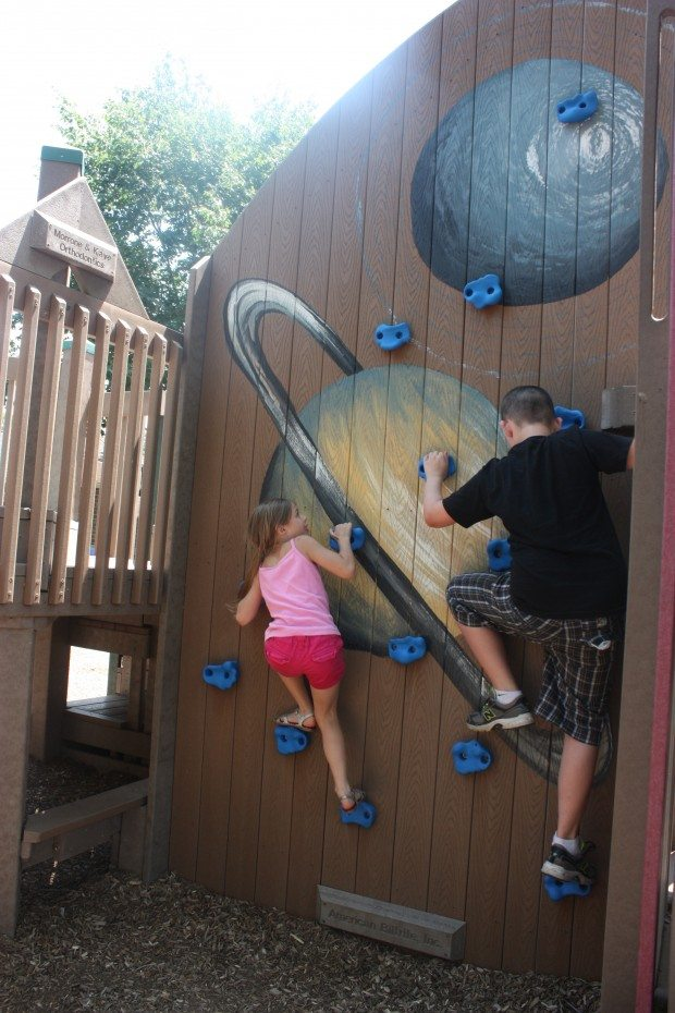Climbing up the rock wall at Fullerton Park in Burlington County.