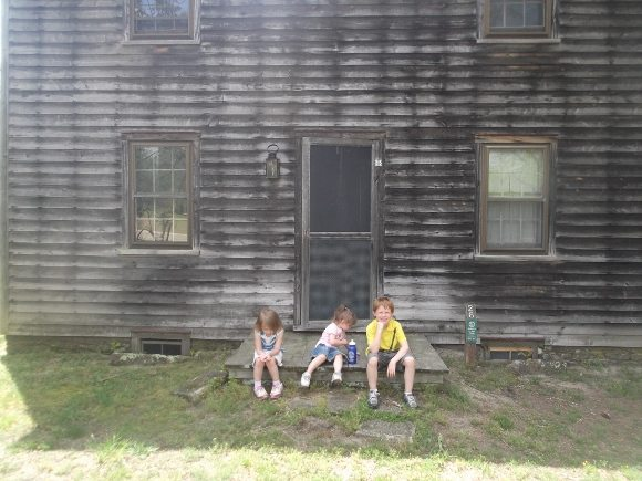 Here are my children in front of one of the old cottages
