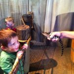 "Getting up close with an alligator hatchling, ""Mini-Mike"" at Adventure Aquarium."