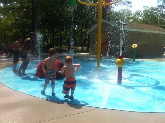 My Oldest showing his brother all of the water features at Bridgeton's new Splash Pad.