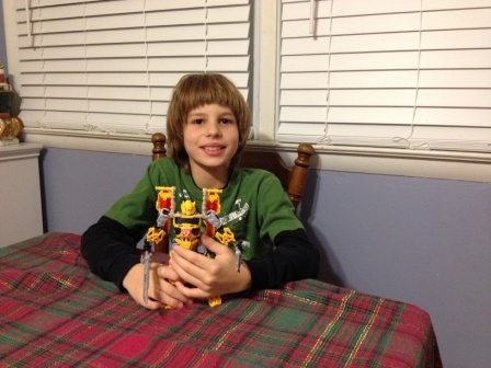 All smiles with his Transformers Construct-Bots.