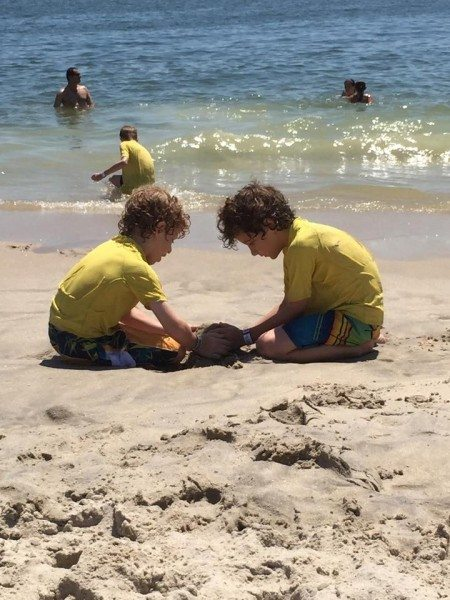 Boys playing on a New Jersey beach
