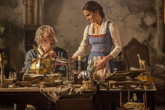 Belle's dad, Maurice is tinkering with a music box.