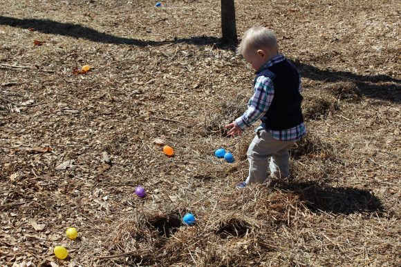 toddler boy hunting for Easter eggs in New Jersey