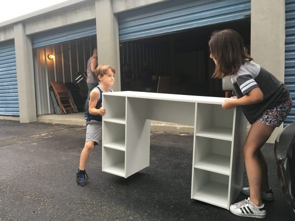 kids helping with the moving process