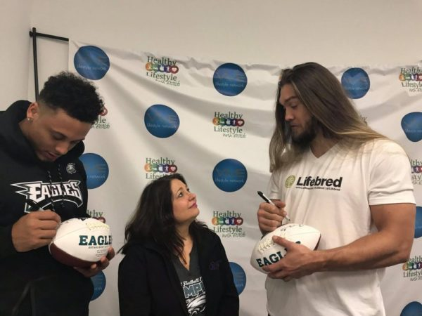 Eagles Tight End Billy Brown, with Linda Kuepper, Co-Founder and CEO of the Autism Cares Foundation and Eagles Defensive End Bryan Braman