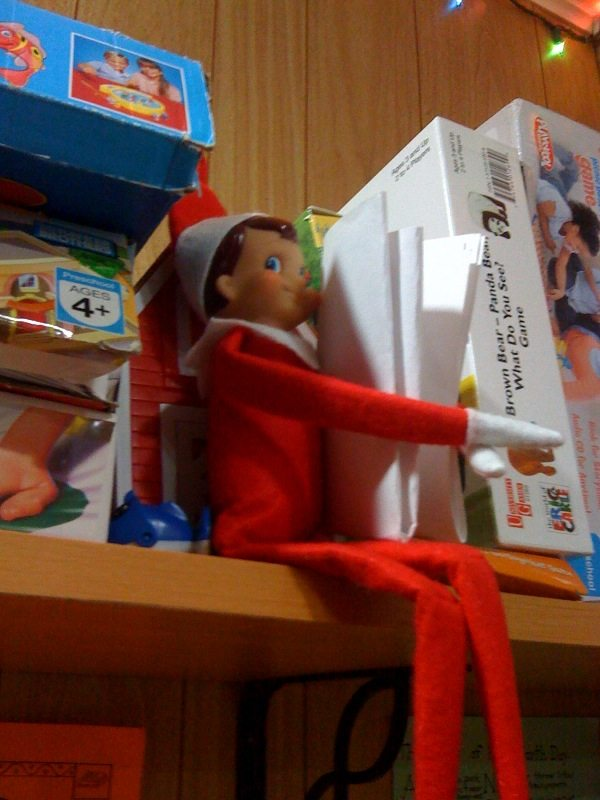 elf on the shelf on bookcase