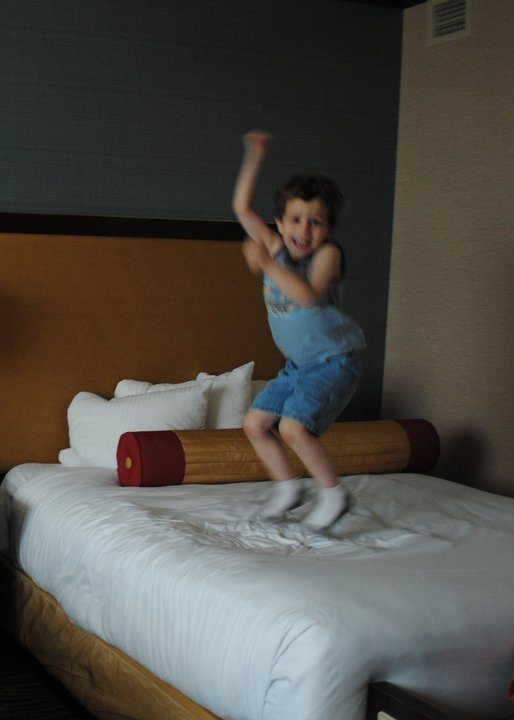 jumping on bed in Harrah's Resort and Hotel room in Atlantic City