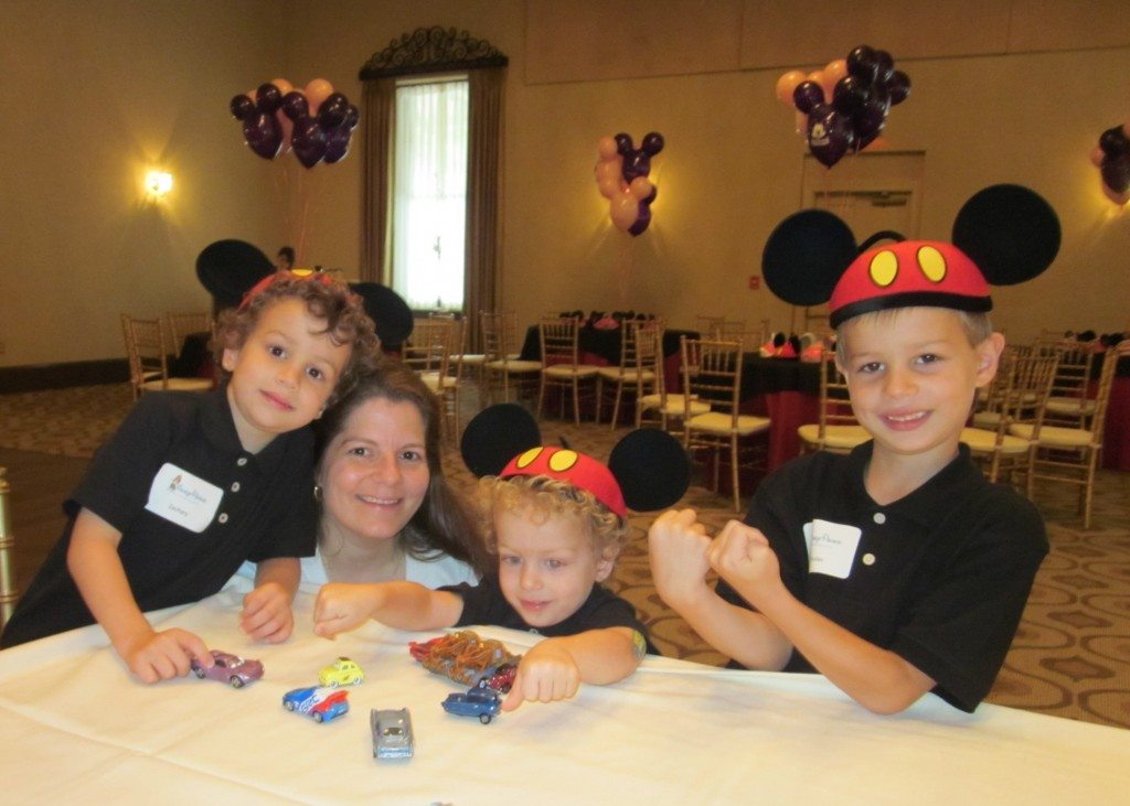 family with mickey mouse hats