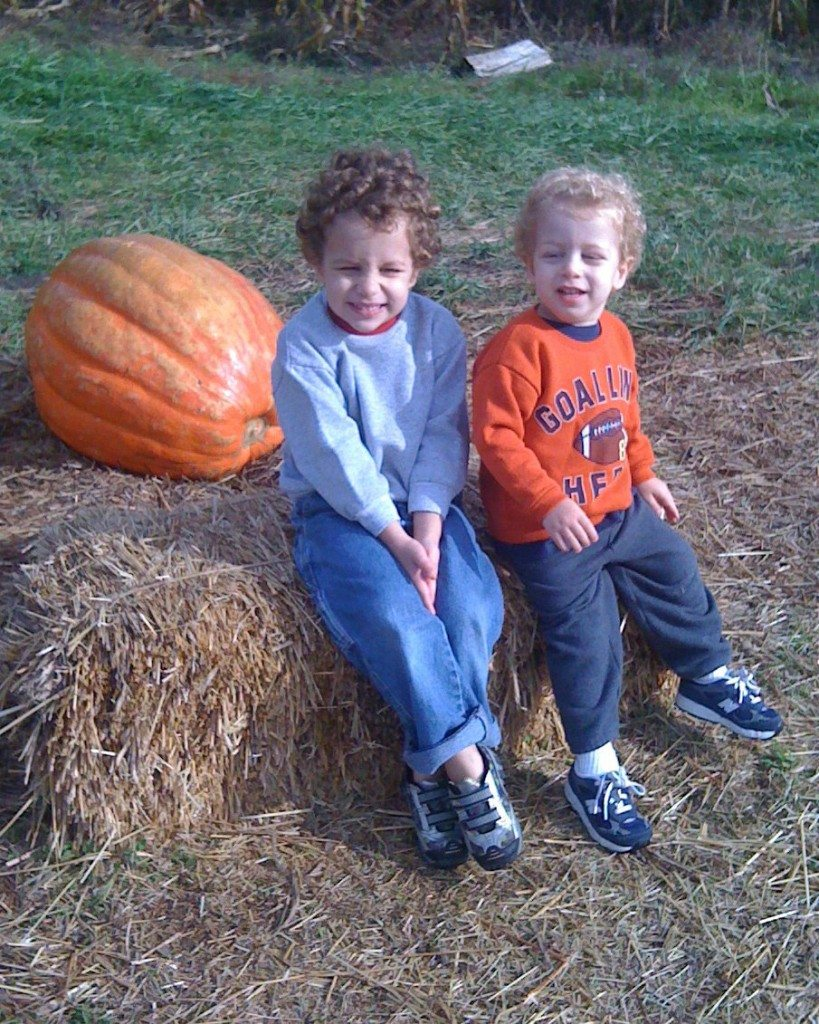 Brothers with large pumpkin at Butterhof's Shady Brook Farm in Galloway