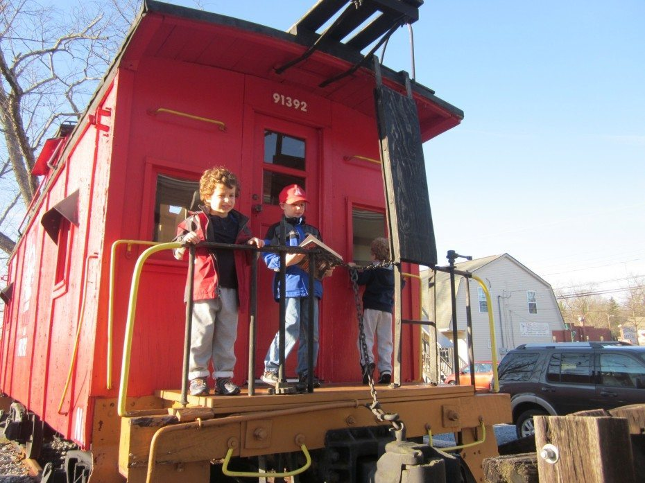 Outside the Patcong Valley Railroad Christmas Train display you can pose for pictures with real trains. |Photo Credit Jersey Family Fun