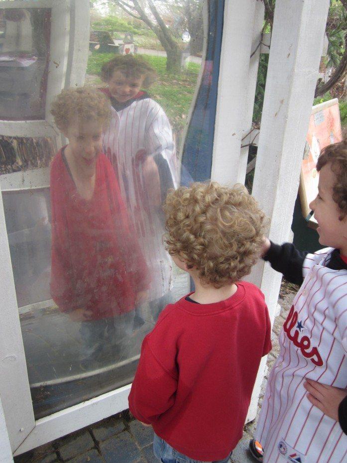 The Alice in Wonderland garden at the Camden Children's Garden offers a fun house mirror