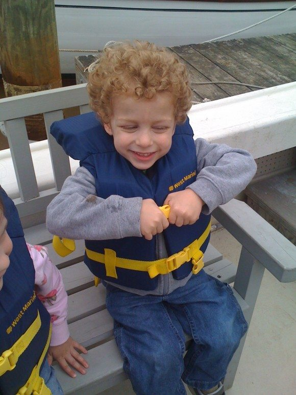little boy in life jacket on boat during Tuckerton Seaport Boat Tours