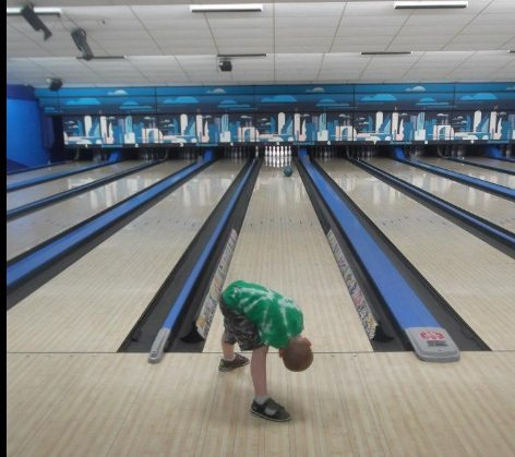 Kid bowls at a New Jersey bowling alley