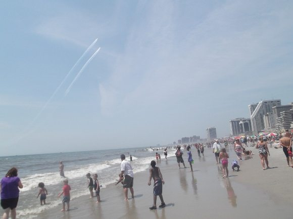 Look up in the sky and see as the children play in the water the planes were just over head