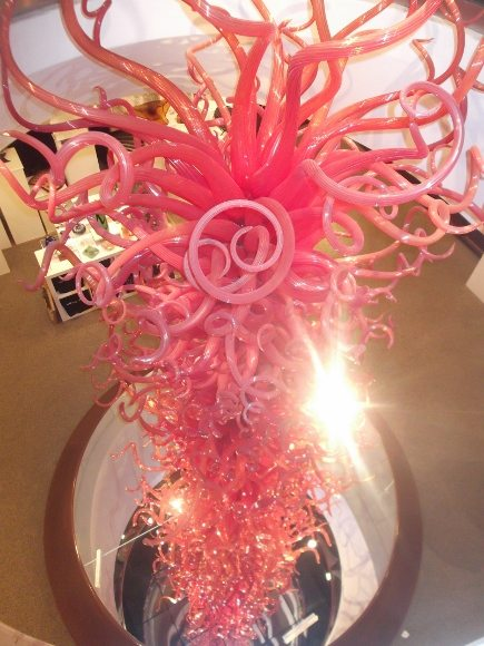 """""""The Flame of Liberty"""" by Dale Chihuly 20 ft glass sculpture through the middle of the Museum"""