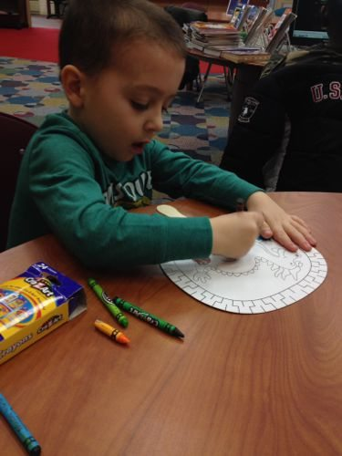 Coloring a dragon fan for a Chinese New Year Event in New Jersey at Rahway Library