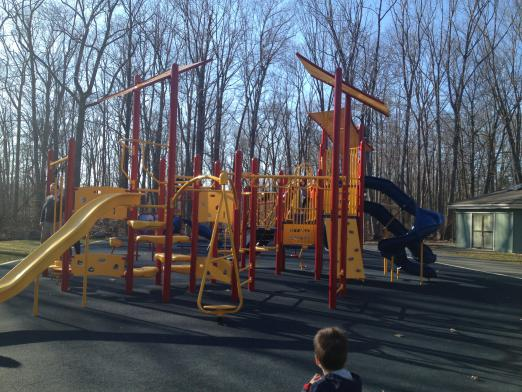 The playground for children ages 5-12 boasts several slides, rock wall, and many climbing options.