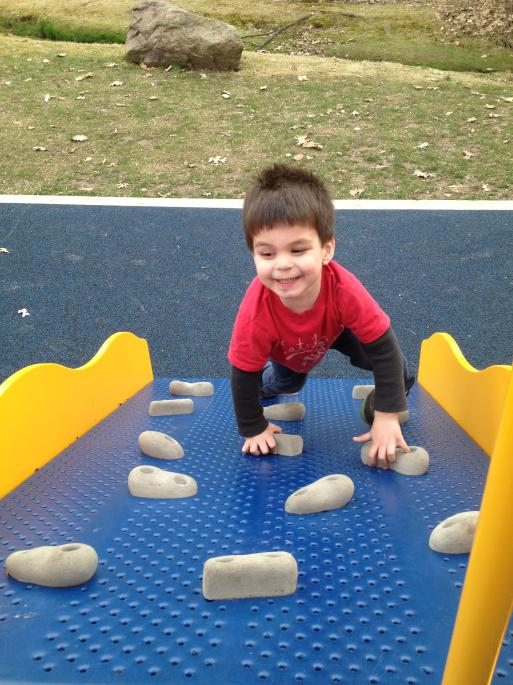 There is a rock wall in both children playgrounds.