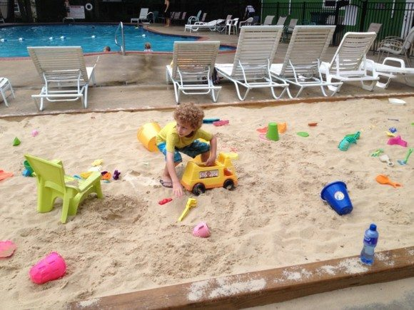 Love the sandbox area in front of the pool.