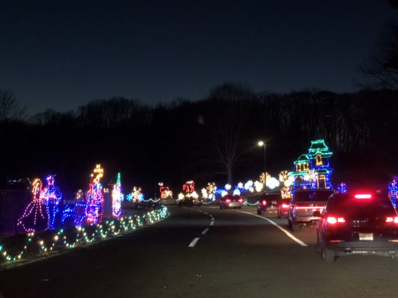 Cars pause to enjoy the light displays at the Magic of Lights in Holmdel New Jersey.