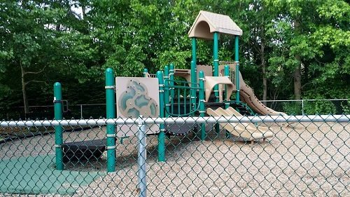 Here is the smaller playground in the park. There is also a fence that goes around it.