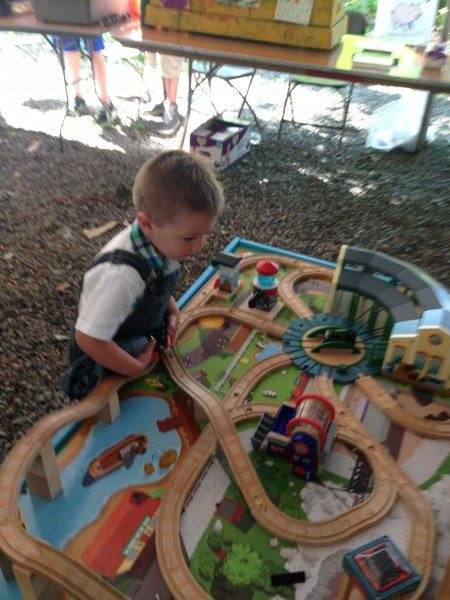 Playing with the train tables at the Imagination Station.