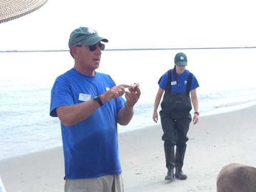 Frank, the Monmouth County Parks program guide with a crab that was caught.