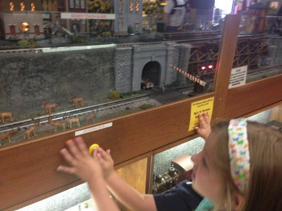 Interacting with the model train at the museum.
