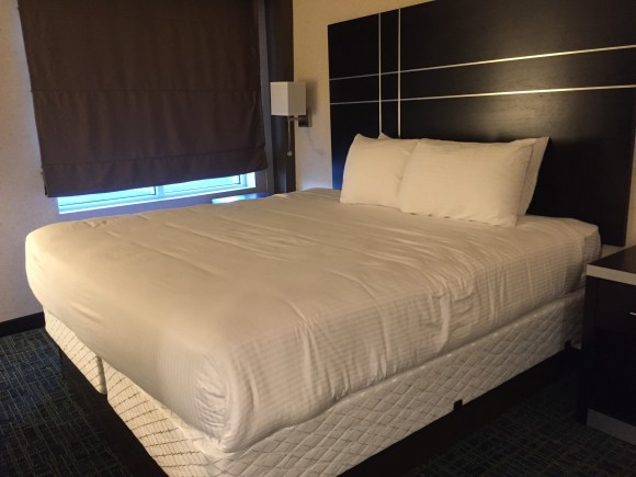 The Warehouse Hotel King Size bed with plush, hypoallergenic bedding.