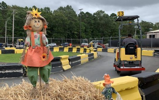 a scarecrow outside one of the rides at diggerland.