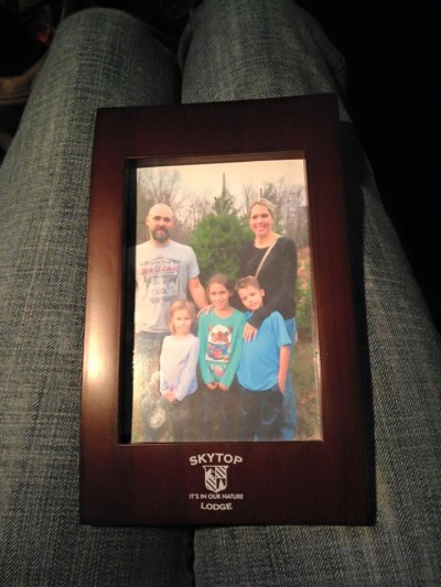 As part of our package, we received a framed photo on checkout of our family with our Christmas tree!