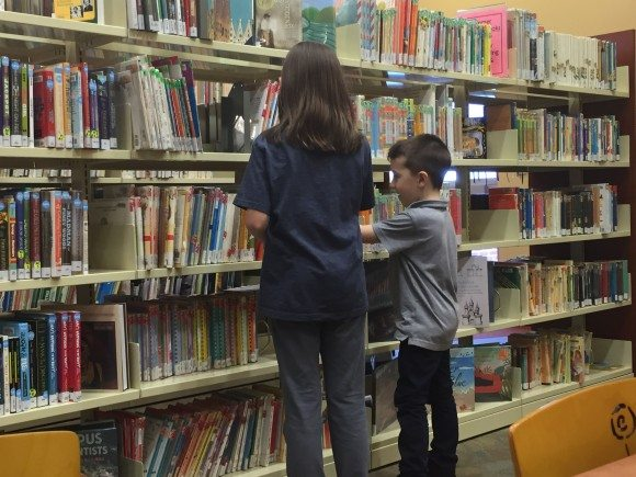Choosing books at our local library