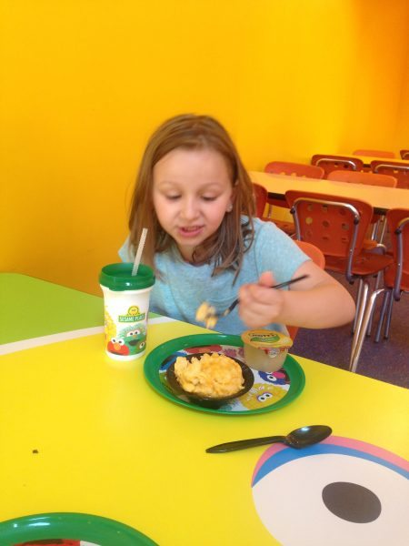 eating macaroni and cheese at Sesame Place