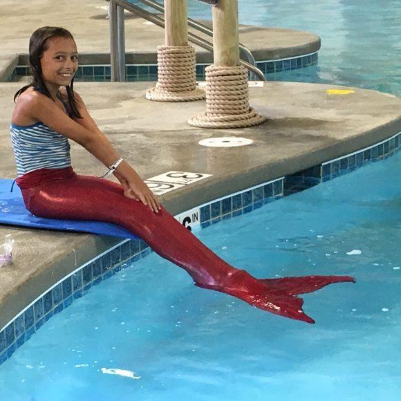 a girl becomes a mermaid at Kalahari Resorts
