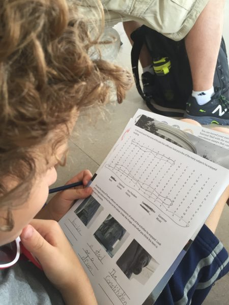 Finishing off his last Washington DC National Mall Junior Ranger badges worksheet at the Thomas Jefferson Memorial.