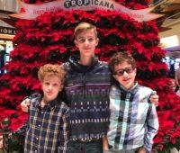 Boys with large red poinsettia tree at Tropicana Atlantic City