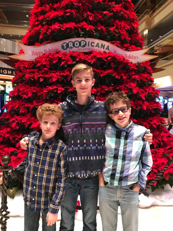 Boys with large red poinsettia tree at Tropicana Atlantic City
