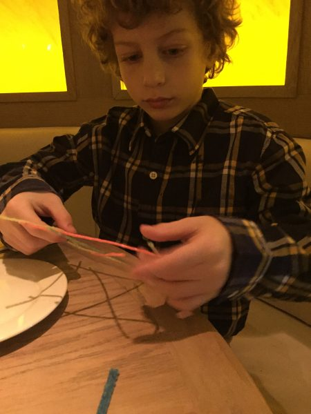 8 year old playing with Wiki Stix at Le Club Avenue restaurant in Long Branch