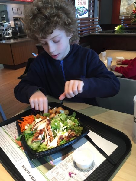 Child eating a Habit Burger Grill salad