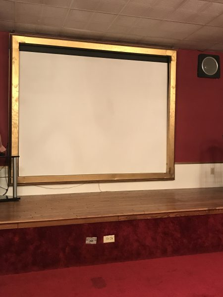 Movie screen in theater at Windwood Inn and Condos at Windham Mountain