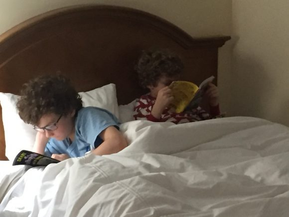 reading in a hotel room