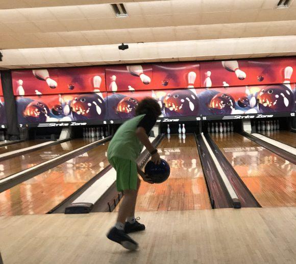 kid bowling in Kids Bowl Free program