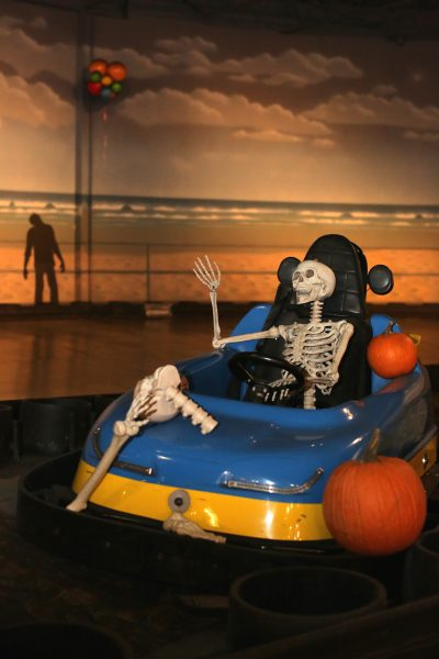 A skeleton drives a go cart during iPlay America Halloween activities