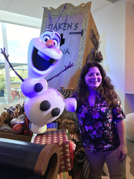 Jenn with Olaf's sleigh in Olaf's Frozen Adventure