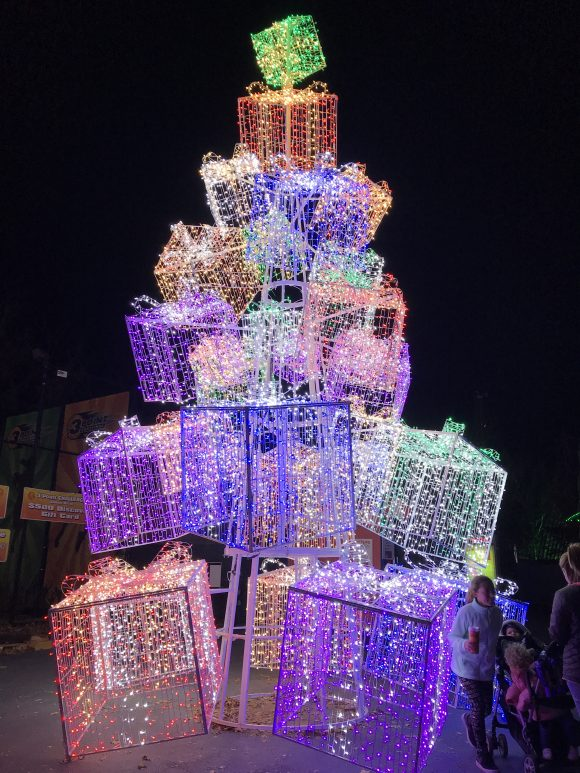 At Six Flags Great Adventure Holiday in the Park Christmas lights you can see a tower of stacking presents.