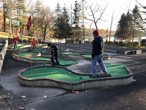 Father and son enjoy a round of mini golf as a Woodloch Resort activities. - Photo Credit Jersey Family Fun