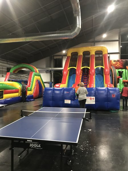 Smugglers Notch Kid Zone 2.0 ping pong and inflatable slide - Photo credit Jersey Family Fun
